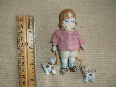 vintage miniature painted bisque porcelain doll, girl w/ 2 puppies on a leash