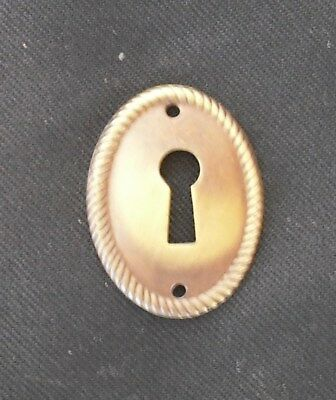 Set of 9 Keyhole cover escutcheons, solid stamped brass