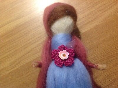 Beautiful Needle felted fairy, handcrafted, in pretty soft colours.