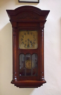 Antique wall clock, with brass pendulum and bevelled glass, good working order