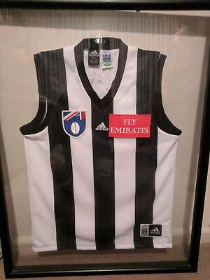 1999 Collingwood Signed Footy Jumper by WHOLE TEAM!