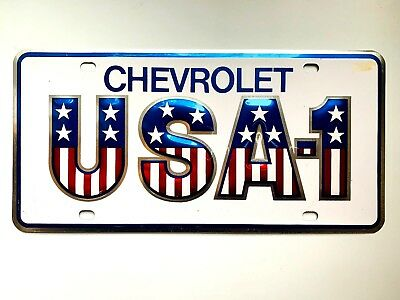 USA-1 1970s Chevrolet Front Old License Plate Small Holes Original Dealer Tag