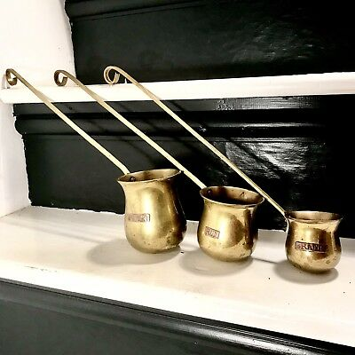 Vintage brass Punch ladle measures of whiskey, rum and brandy