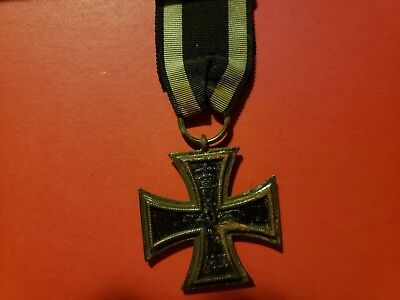 Genuine Imperial German Iron Cross 2st Class (1914) on black and silver ribbon