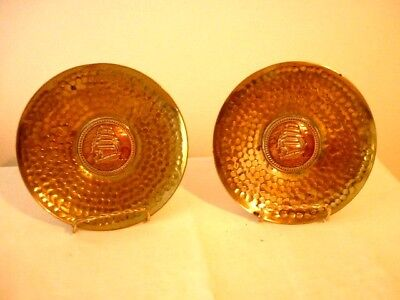 A Vintage Pair Of Beaten Brass Plates With Copper Galleon Center