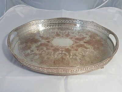 An Antique Silver Plated Gallery Tray On Clawed Legs by john turton & co.