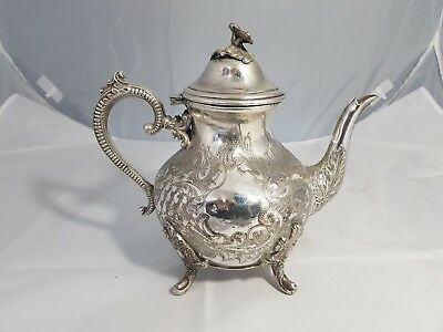 A Beautiful Antique Silver Plated Embossed Tea Pot with engraved patterns.