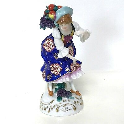 German Dresden Style Figurine of Man With Fruit Basket