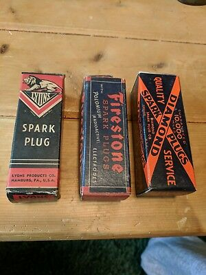 3 Vintage Spark plug Boxes. Two with plugs.