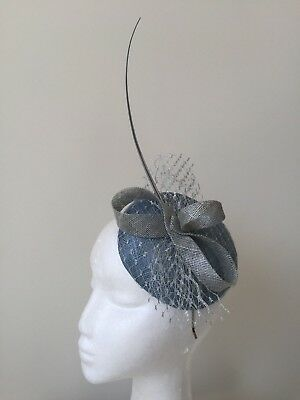 Blue fascinator with silver loops, feathers and netting on a silver headband!