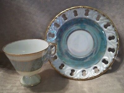 """Cup and saucer 7023 5"""" D Porcelain ,2 3/4""""H There are holes around the saucer."""