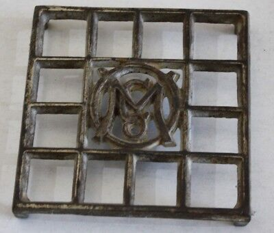 "Vintage Antique Cast Iron Metal Trivet marked ""M Co."" in a circle"