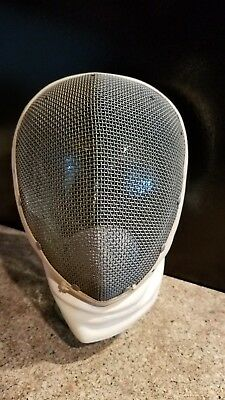 Vintage fencing mask with fighting sword