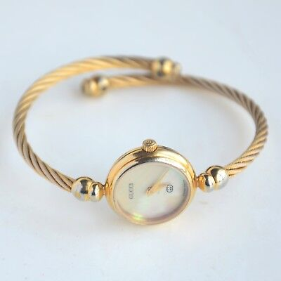 87a44aa42e3 Gucci 2700L Swiss Made Mother of Pearl Gold Plated Wraparound Bangle Women  Watch