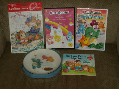 Lot of 5 Care Bear Collecitbles New Plate & Puzzle, Used book & 2 DVDs