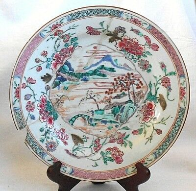 C19Th Chinese Plate Decorated With Mountains And Flowers Within A Border