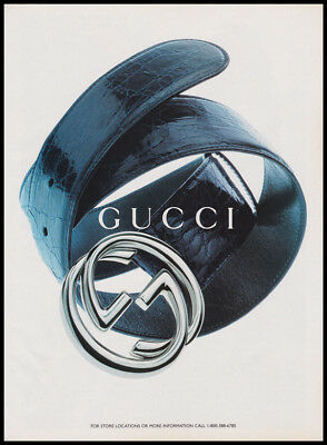 Gucci belt 1995 print ad - image of rolled up belt with logo buckle