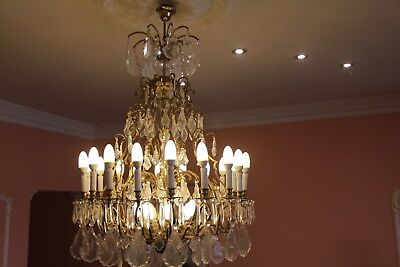 A magnificent Antique Crystal Chandelier! Brass and beautiful glass crystals