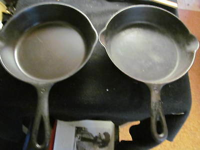 two number 5 cast iron skillets old vintage made in USA 8 inch dia.