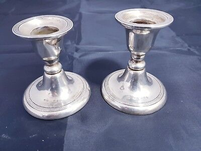 A matching Pair Of Solid Silver Candle Holders.birmingham.1910