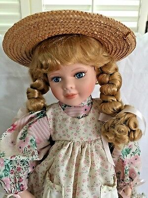 Boyds Yesterday's Child Doll carries a pink metal sprinkler & a basket of flower