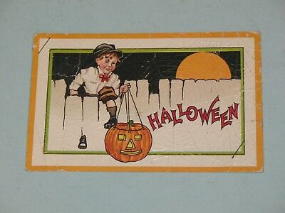 1910s HALLOWEEN POSTCARD WITH EMBOSSED SPIDERWEB OVER IT