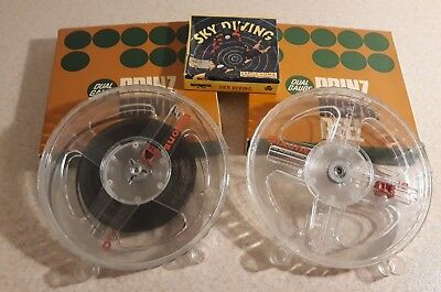 "2 x boxed cased empty reels 5"" 200ft dual gauge + 50ft Super 8 Sky Diving film"