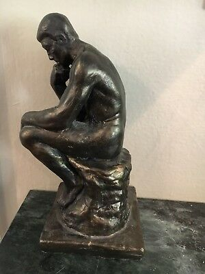 """""""thinking man"""" statue, lightweight resin and about 7 inches tall"""