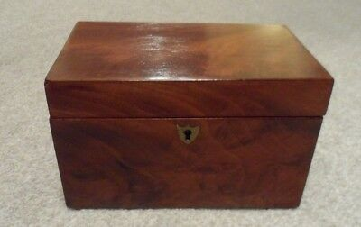 Antique Victorian tea caddy in figured mahogany with two lidded compartments.