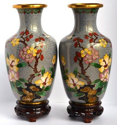 A mirrored pair of late Victorian or early 20th Century Chinese cloisonné enamel
