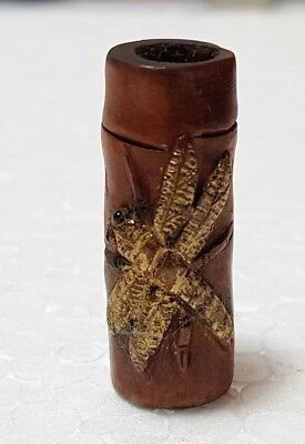 A lovely Meiji period carved Ojime a bamboo stem with gilt Dragonfly.