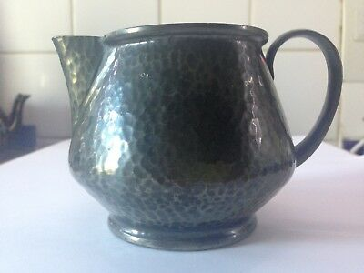 Tudric hammered pewter milk jug by Haselers of Birmingham for Liberty of London