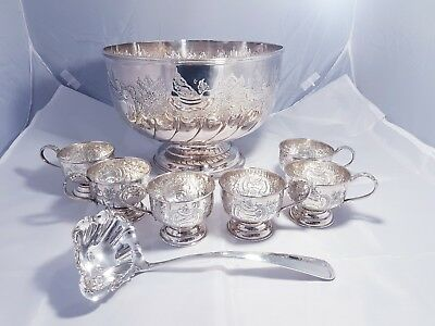A beautiful Antique Hand Chased Silver Plated Punch Bowl.6 Cups And Ladle.ornate