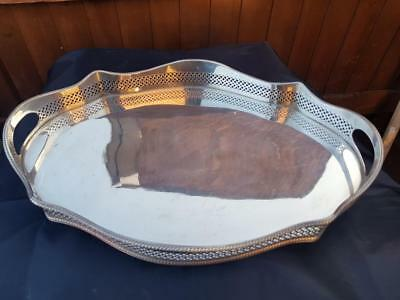 a beautiful antique silver plated rise and fall gallery tray with mirror effect.