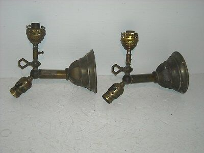 Pair of matching antique brass combination gas/elect. sconces.