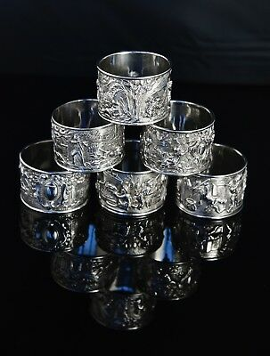 Set of 6 Antique Silver Plated Napkin Rings with high relief Bacchanalian scenes