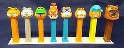 """PEZ DISPLAY RAIL White 12"""" Holds 1-12 Pez Dispensers  $ave With Bulk Offers"""