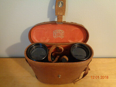 Antique tasco deluxe 7x50, with original leather carrying case, made in Japan