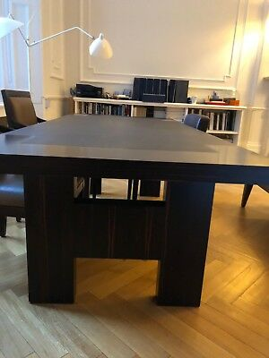 Brown Dinning Table Made Of Wood And Leather