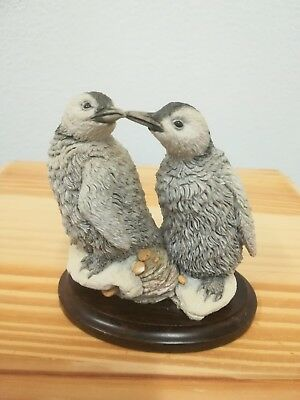 Country Artists pair of baby Penguins