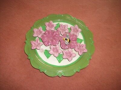 Antique decorative plate with bee, green and pink.