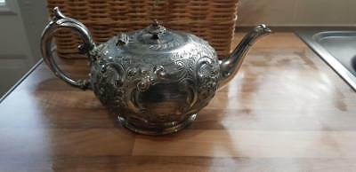 Paul's Antiques -an antique silver plated embossed tea pot by j.h.potter.