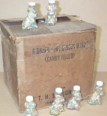 old glass candy or general store container with original colorful candy contents