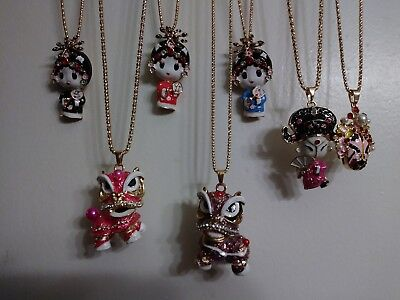 7-pc lot of Betsey johnson Chynna dolls and 1- masks and to 2- Chinese Dragons