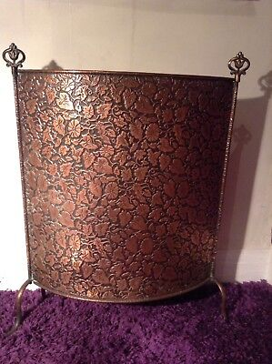 Victorian Copper Embossed Fire Screen.