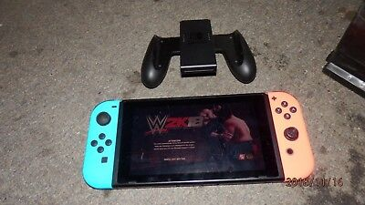 Nintendo Switch -  Gray Console (with Neon Red/Neon Blue Joy-Con)  WIth WWE 2k18