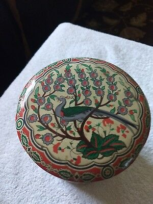 Vintage painted metal canister with peacock made in france