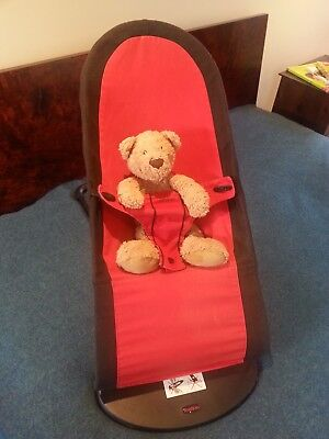 Baby Bjorn bouncer with black and red cover in good pre-loved condition