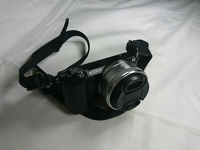 Sony A5000 mirrorless frame camera with SEL16F28 16mm f2.8 pancake and battery