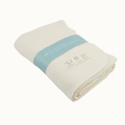 Quality cot mattress protector- pure NZ wool- excellent condition